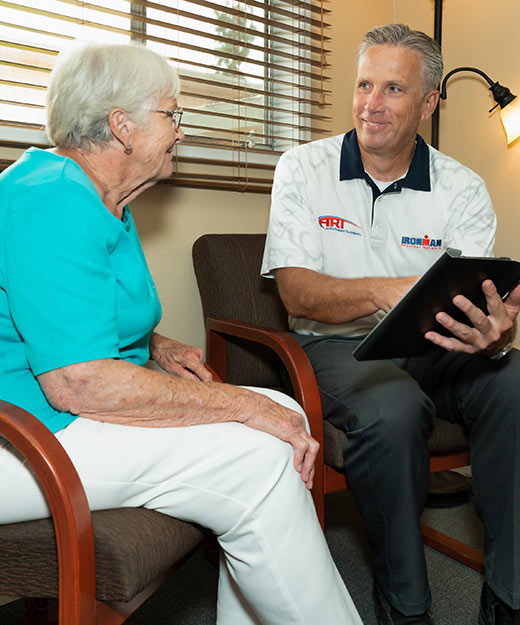 Chiropractor San Diego CA William Porath Consulting with Patient